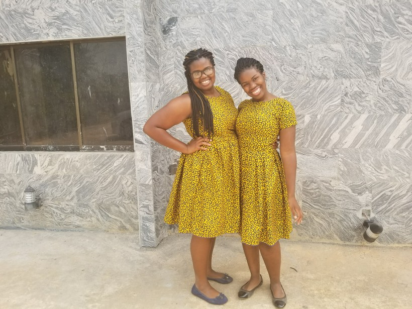 Sisters in Nigeria modern dresses in a Nigerian village